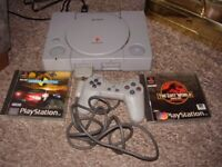 playstation with games including lost world