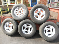 Nissan Navara wheels - 4 alloys with General grabber AT tyres, 1 steel with new Bridgestone Dueller