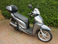 HONDA SH 300 Silver - 2011. 2750 Miles. Mint conditions. Heated Grips, Leg Cover, Two top boxes