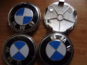 BRAND NEW BMW ALLOY WHEEL CENTER CAP SET OF FOUR.