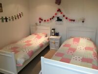 children's white twin beds from Room to Grow