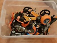 Box of action man. Includes 5 dolls and mini dolls plus vehicles