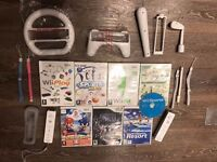 2x Official Wii Controllers (Wiimotes), 8x Wii Games, and accessories