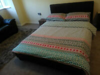 Dark brown leather double bed with mattress in very good condition