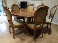 Wooden round dining table and 8 matching chairs - very good condition!