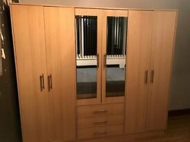 Double wardrobe, including central mirrors and in good condition