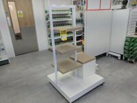 Product stand with height-adjustable shelving and separate pedestal.