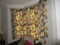 A pair of curtains in Sanderson Dandelion Clocks (Blackcurrant & Lime) fabric
