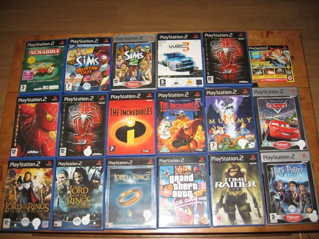 silver slimline playstation 2 (PS2) with 17 games bundle and singstar mics (Lcoal collection only)