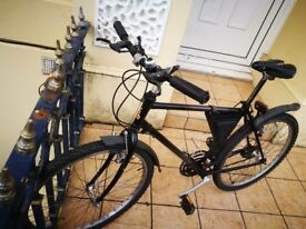 Super Clean Men's Raleigh. Black with slight Purple. Great condition, brakes and gears.