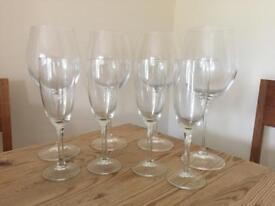 4 champagne glasses and 4 large wine glasses