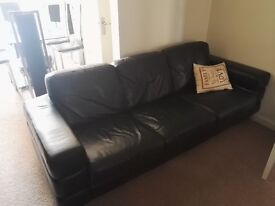 BLACK LEATHER SOFA 1x 3 SEATER AND 1 x 1 SEATER