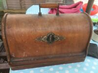 Antique Singer sewing machine in good condition for pre-1930 still usable with original case