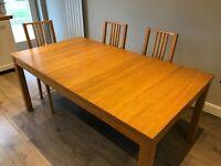 Ikea Bjursta oak extendable table & four chairs.