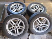 FOUR X ALLOY WHEELS AND TYRES. 5 STUD. DISCOVERY 2 TD5