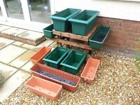 10 Plastic planting troughs and stand. all good condition.