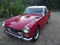 MG Midget 1275 cc. Red with cream soft-top. 1972