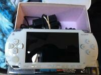 White PSP 1000 in almost perfect condition scratch free screen Comes with an official charger