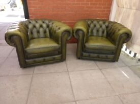 A Pair Of Green Leather Chesterfield Club/Armchairs