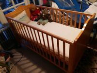 Cot bed for sale - excellent condition £50 with mattress and sheets light pine colour, Cockfosters