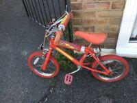 Boys red toddler bike