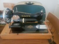 Vintage Singer sewing machine with travel case