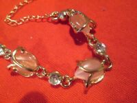 Gold plated bracelet with pink stones