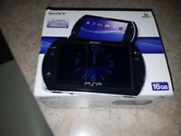 PSP Go 16gb boxed and 4 games