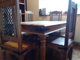 Solid Wood Dining Table & 6 matching Chairs with Wrought Iron detail