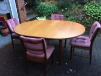 6 seater solid wood dining table and 4 chairs