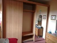 Large triple door wardrobe