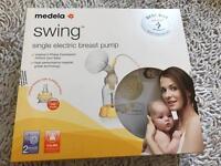Medela Swing electric breast pump and Calma