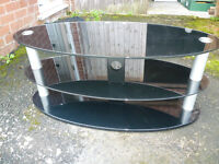 Stylish Oval Glass TV Stand