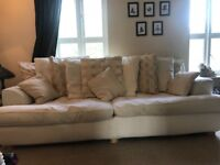 Large four seater sofa with scatter cushions