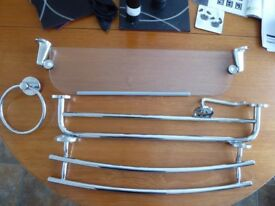 A selection of bathroom fittings. Toilet roll holder, glass shelf, two towel rails & towel hoop