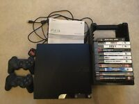 PS3, 2 controllers and 11 games with holder - excellent condition