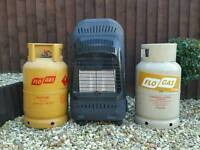 Gas heater with two gas bottles in good condition