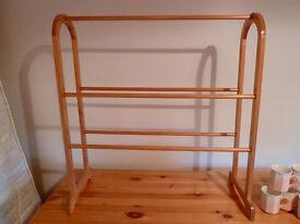 Wooden, free standing towel rack.
