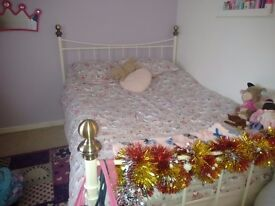 Double white metal frame bed with mattress