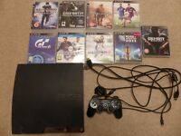 PS3 320Gb slim console with 9 games.