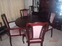 hardwood dining table and six chairs