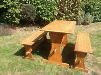 Solid pine table and benches for outdoor dining