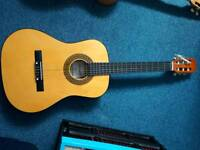 Acoustic guitar 3/4 size. Free case.