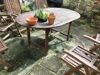 Wooden garden table seats 6 needs repainting