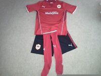 Cardiff City youth Red Football kit, shirt, shorts and socks rarely worn.
