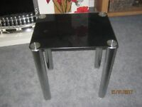 Small black glass table