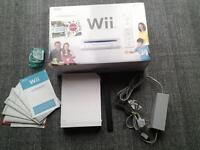 Nintendo Wii console (with original packaging) and games for sale