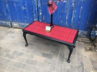 this is a gorgeous coffee or lounge table, black and red tartan