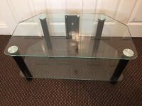 GLASS TV STAND, EXCELLENT & CLEAN CONDITION, SIZE Wide 30 Inch, Deep 17 Inch, Hight 14 Inch.
