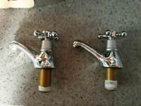 Chrome and steel bath taps